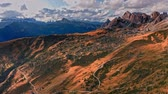 Passo Giau in Dolomites in autumn, Italy, aerial view