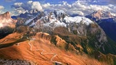 Serpentine in Passo Giau and brown hills, Dolomites, aerial view