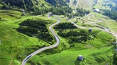 Aerial view of winding road at green Passo Gardena, Dolomites