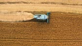Top view of blue harvester working on field