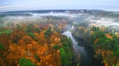 Foggy sunrise at the river in autumn, aerial view