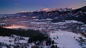 Aerial view of snowy sunset over Zakopane in winter Stock Footage