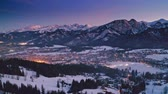Illuminated Zakopane city after dusk in winter, aerial view