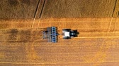 Aerial view of tractor plowing field after harvest in autumn Vidéos Libres De Droits