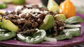 saláta : Plate of Oaxacan cuisine of avocado salad with grasshoppers being placed on table