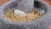 ягода : Closeup curved pan from right to left of mortar and pestle filled with ground wheat berries