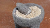 ягода : Curved pan from right to left of mortar and pestle filled with ground wheat berries Стоковые видеозаписи