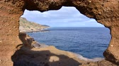 Time lapse view of Kalanianaole coastal ocean on eastern end of Oahu through natural window in eroded earth