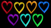 Cute animation with rainbow hearts on black background. Wideo