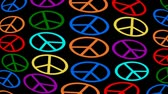 aufstand : Multicolored anti-war symbole moving on black background, hippies movement, 60s retro, 70s retro