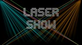 paprsek : Laser show, white digital lettering on black background with multicolored moving rays and beams