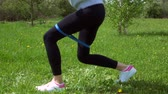 bunda : fitness, sport, training and people concept - woman doing abdominal exercises in park. legs workout Stock Footage