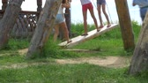 mladistvý : kids of boys and girls swinging standing on a big swing.