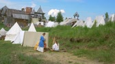 sivil : Life of Civilian People at Village. Medieval Reenactment. Stok Video