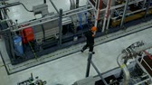 A service engineer inspects equipment at work. Stok Video