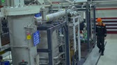 デバイス : A mechanic inspects a compressor installation at the factory 動画素材