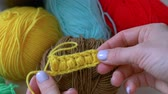meada : girl dismisses the crochet yellow thread Handmade crochet close-up.