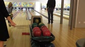 bowling alley : People playing a game of bowling at the small town of bowling alley in Kiev, Ukraine, 12022017 Stock Footage