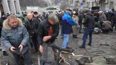 officers : Ukraine. Kiev. December 5, 2017. People dismantle paving stones on the road and build barricades. Protest against the detention of Saakashvili.
