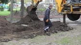 mayın : Kiev, 19 April 2018, Ukraine: The bucket of the excavator digs the ground Stok Video