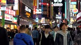 базарная площадь : Crowd of people in Shibuya shopping street district. Shibuya is known as one of the fashion centers of Japan for young people, and as a major nightlife area.