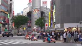 go cart : Mario Kart running on Shibuya Crossing (4K UHD). Tourist Rent a Go-kart can drive on Shibuya District, Harajuku and Omotesando all the famous shopping and sightseeing spot . Tokyo, Japan