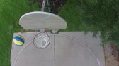 выиграть : Aerial Overhead Basketball Shot on an Outdoor Court 02