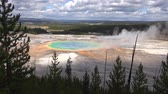 fiel : Amazing steamy lake with colorful geyser in Yellowstone national park forest, 4k