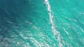 surfe : Top 4k aerial drone cam of professional windsurfer gliding in calm waves of turquoise blue ocean water Hawaiian seascape Stock Footage
