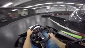 go cart : Young man marvellous first person pov driving leisure go-cart car on karting lap race extreme sport action inside arena