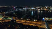 Bridge across river in big modern Philadelphia city downtown in night light illumination in stunning 4k aerial cityscape Stock Footage