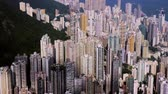 Hong Kong Island. Tight aerial forward shot flying over office buildings and skyscrapers.