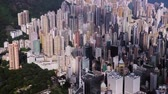 aerial drone footage of rooftops and streets in the densely populated Kowloon area in Hong Kong, one of Asias most iconic modern cities. Stock Footage