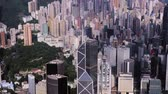 aerial drone footage of rooftops and streets in the densely populated Kowloon area in Hong Kong