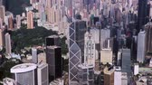 Abstract aerial drone footage of rooftops and streets in the densely populated Kowloon area in Hong Kong