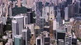 Top view aerial from flying drone of a developed Hong Kong city with modern skyscrapers with contemporary design. China town with business and financial centers