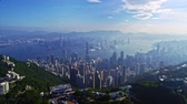 Magnificent aerial drone cityscape panorama of urban architecture Hong Kong city in cold blue sky morning sunshine light