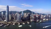shooting from a drone, view from the sea at the skyscrapers of Hong Kong, against the backdrop of beautiful mountains Stock Footage