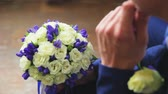 wedding : the groom with the brides bouquet Stock Footage