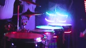 alight : The man is playing on the luminous drums Stock Footage