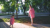 cabelos claros : young happy family with little beautiful baby with blue eyes walking in summer park at sunset.
