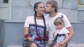 doce : happy family with a little beautiful baby , Mother and daughter in dresses with candy