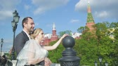 a young married couple is walking around Moscow, a wedding in Russia on the red square Stock Footage