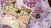 hryvnia : Money rotate on the table. Bills and coins. The overall plan. Hryvnia. Stock Footage