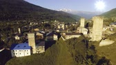 famous : Overview of Mestia, famous for its Svan towers, in the mountainous Northwest of Georgia in the Caucasus Stock Footage