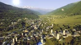 defensiva : Overview of Mestia, famous for its Svan towers, in the mountainous Northwest of Georgia in the Caucasus Stock Footage