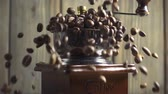 macchiato : Pouring coffee beans into wooden vintage grinder, slow motion Stock Footage