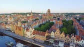 exterior shots : The old town of Gdansk architecture in sunset light. Aerial shot. Channel and buildings - top view