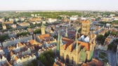 uzun boylu : The old town of Gdansk architecture in sunset light. Aerial shot. Channel and buildings - top view