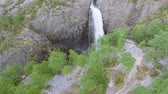 acidentado : Breathtaking aerial view on the huge waterfall and the valley around it. Bird view. Norway, Manafossen. Stock Footage